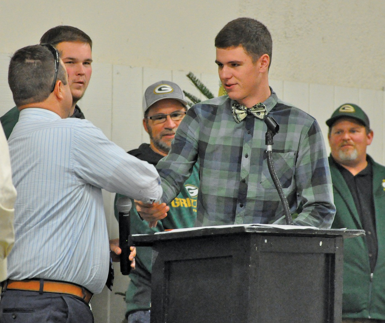 MCHS's JC Davies was awarded Co-MVP of the varsity team. He is shown accepting the award from coach Ryan Oliphant (left).