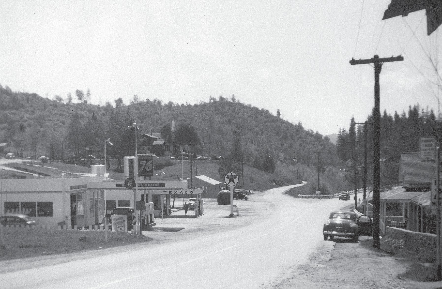 """""""Mariposa County Flashback"""" is a collaboration between the newspaper and the Mariposa County Museum and History Center. This photo is looking south from Mariposa circa 1940. There is a 76 service station, a Texaco and """"Big Orange"""" which was a hamburger shop. In addition to featuring photos from the museum, we are also looking for historic photos from our readers. These can include photos with people who are not identified and, if printed, someone may be able to help our readers obtain those identifications. If you have a photo for Mariposa County Flashback, email it to greg@mariposagazette.com. You can also bring it by our office at 5108 Highway 140, Suite B in Mariposa. We can scan it immediately so you can have it back. Submitted photo"""