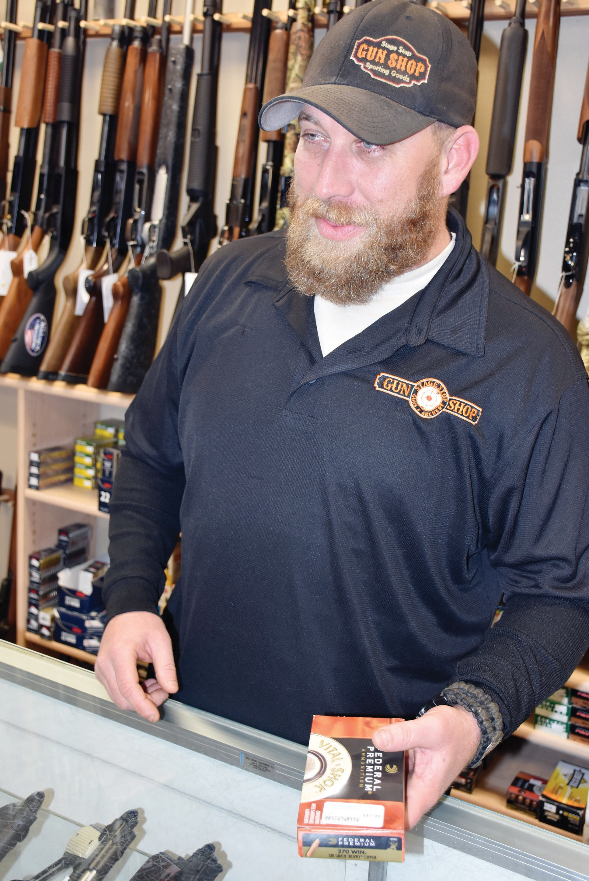 Ronald Luker of Stage Stop Gun Shop in Mariposa is shown earlier this week at the shop. New gun laws go into effect on Jan. 1, 2018 in California. Photo by Nicole W. Little