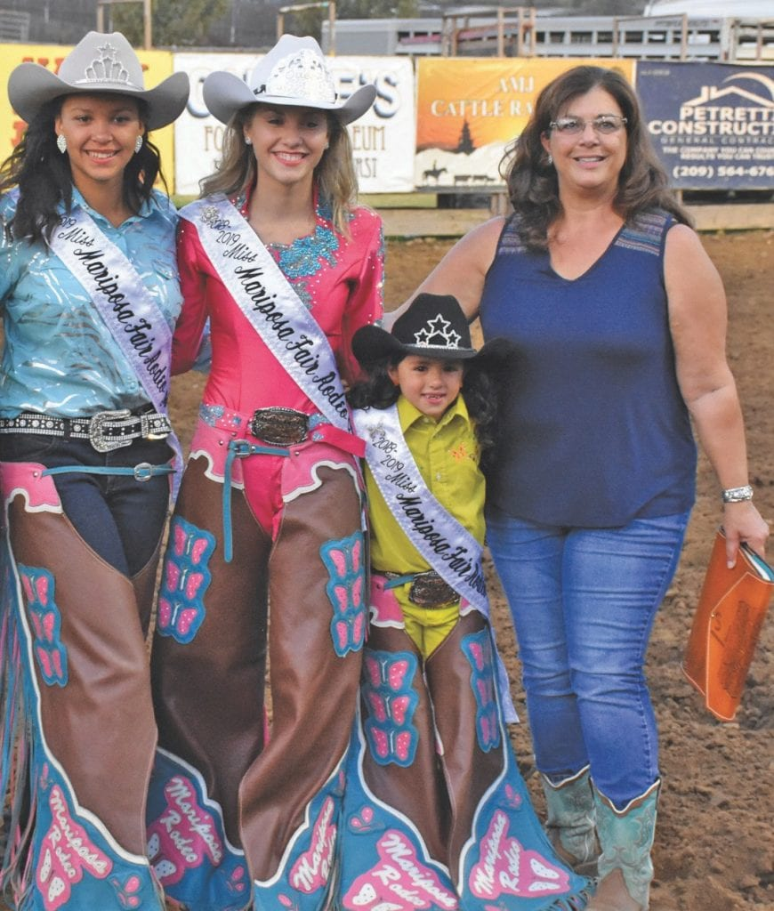 From left, Desiree Turck, Ciana DeSelle, Lily Habeck and Mariposa County Rodeo Royalty coordinator Carol Suggs are shown at Sunday's crowning. Photo by Matt Johnson