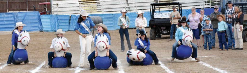 Mariposa Fair Rodeo royalty members shared a good laugh during the bounce horse competition on Friday night. The annual Foster Family Fun Night is always one of the most watched events during the fair. It also generally ends up being a lot of laughs, as well. Photo by Shantel Wight