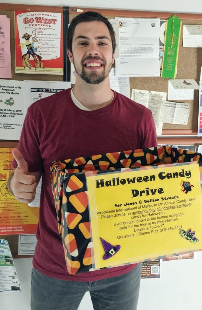 Matt Johnson of the Gazette staff displays one of the boxes used to drop off candy for the current drive. See story for the various locations to drop off candy. Photo by NicoleW. Little