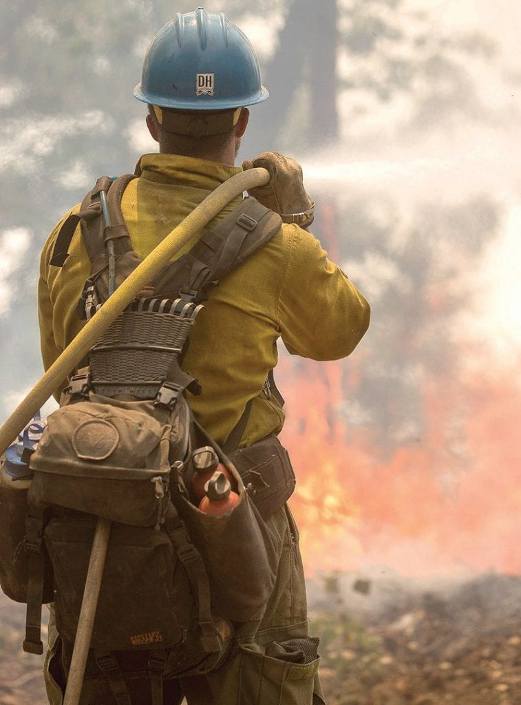 A firefighter is shown battling the Ferguson Fire earlier this year. Photo courtesy U.S. Forest Service