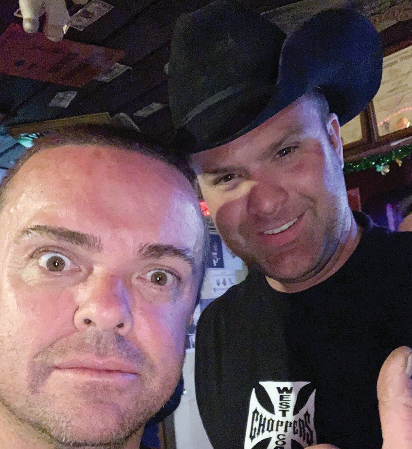 Jason Acuña, better known as Wee-Man, is shown recently at the Airport Inn Bar & Grill with local resident Cody Costa. Submitted photo