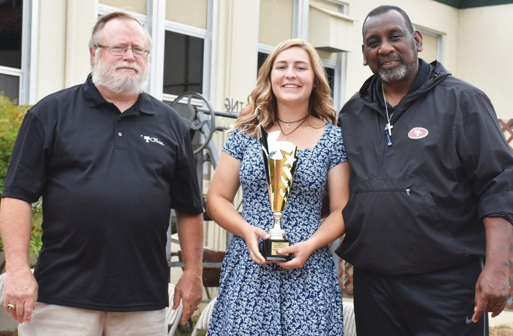 Samantha Matlock (middle) was named the Top Female Athlete at MCHS. She was a standout in both volleyball and softball this year. She is shown with sponsor Eric Cranston (left) and NFL alum Tim Collier (right), who came to the event from Fresno.