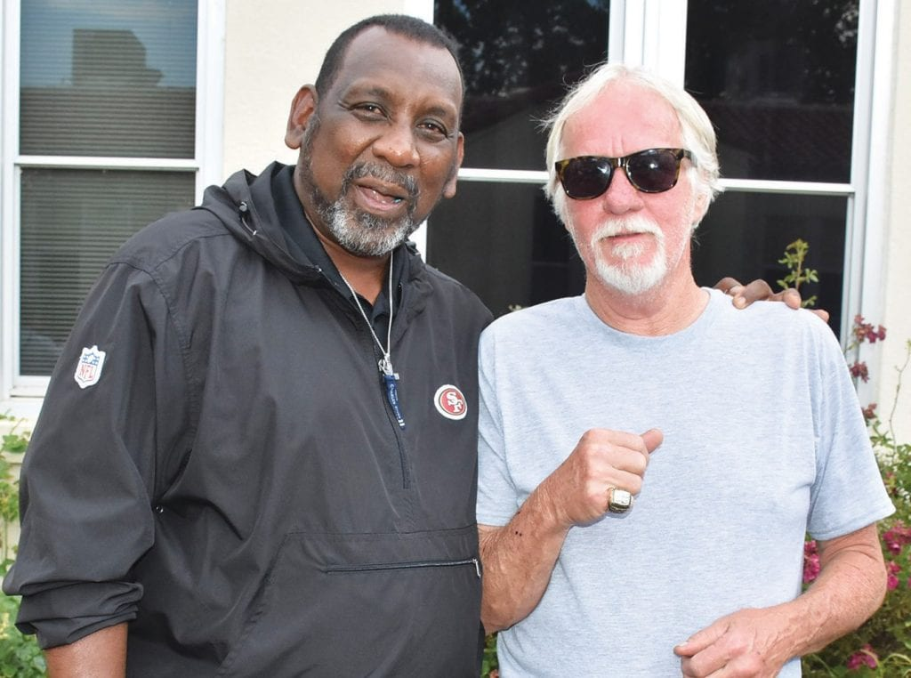 Gazette distribution director John Mabon (right) is shown with former NFL player Tim Collier, who spoke at the event. Collier spent close to a decade in the NFL and won a Super Bowl ring with the San Francisco 49ers. Collier let Mabon try on the ring, and Mabon — a 49er fan — thoroughly enjoyed the experience.