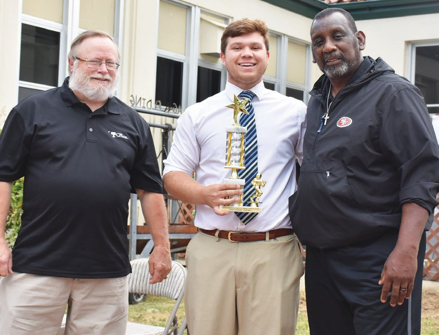 Ryan Leonard (middle), was named Top Football Athlete. He is shown with Eric Cranston and Tim Collier.