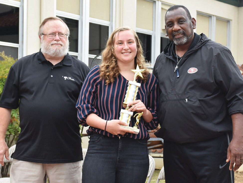 Coury Jones (middle), was named Top Female Swimmer. She is shown with Eric Cranston and Tim Collier.
