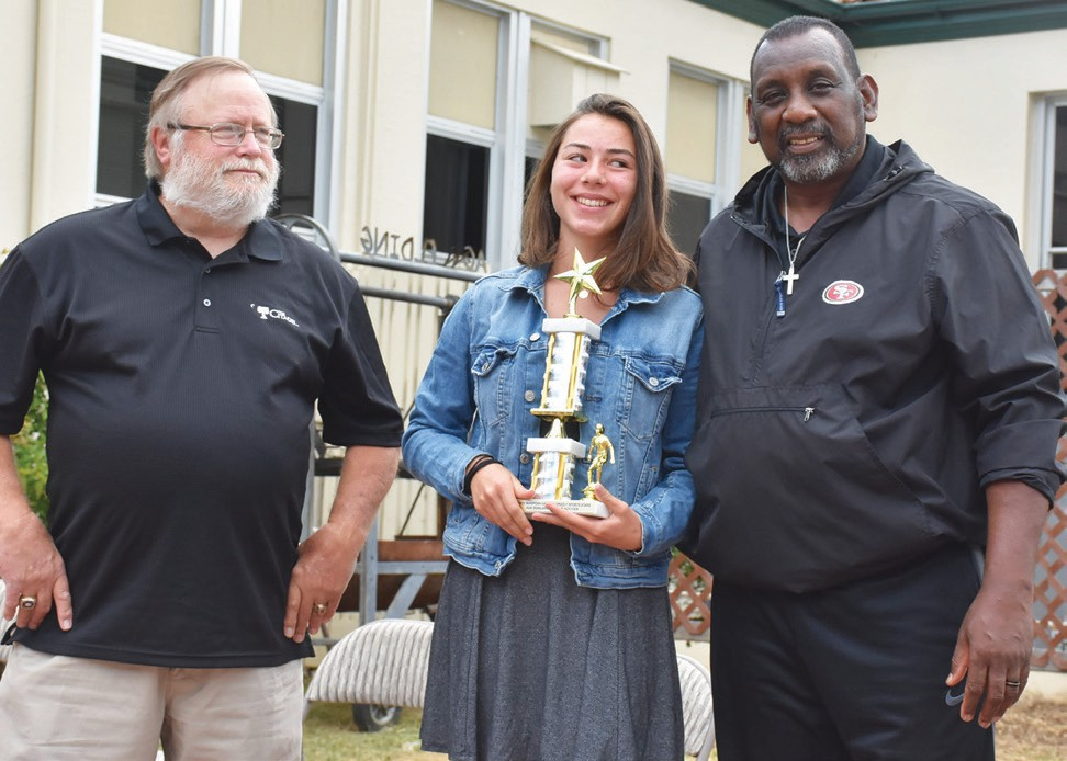 Ava Dunlavey (middle), was named Top Female Soccer Athlete. She is shown with Eric Cranston and Tim Collier.