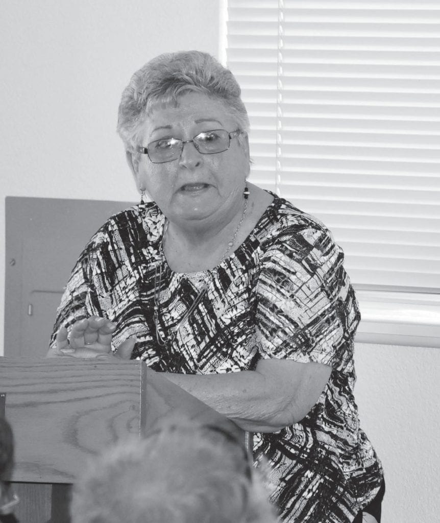 Janice Stoel, the widow of Kent Stoel who was badly injured in the fire, speaks to the audience during the ceremony. She spoke about the difficulties of the family members as well as how her husband lived a full life but always suffered from the injuries he sustained during that fateful day. Photo by Nicole W. Little