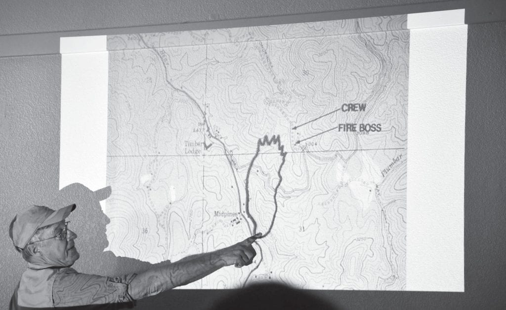 """Patrick """"Smiley"""" Tierney used various maps to explain to the audience where the fire was located as well as where the fire engine was trapped when flames overcame the crew. Photo by Nicole W. Little"""