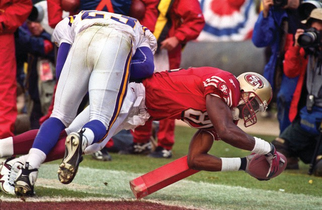 """San Francisco 49ers vs. Minnesota Vikings at Candlestick Park on Saturday, Jan. 3, 1998. The 49ers beat the Vikings 38-22. Minnesota Vikings defensive back Torrian Gray (23) attempts to stop San Francisco 49ers wide receiver Terrell Owens (81) from scoring a touchdown. """"I received first place sports photo from Sacramento Press club for this shot of T.O.,"""" Golub explained."""