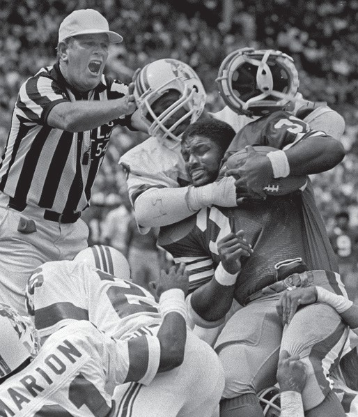 """San Francisco 49ers vs. New England Patriots at Candlestick Park Sunday, Aug. 14, 1983. Preseason game. New England Patriots linebacker Tim Golden (59) tackles San Francisco 49ers running back Carl Monroe (32). """"I received first place in the San Francisco Press Club contest,"""" Golub said."""