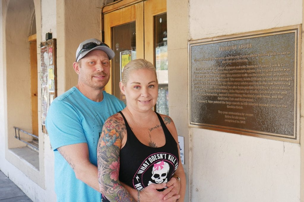 Erin and James Baker are shown in front the Gold Coin, the business they bought about a year ago. Photo by Greg Little