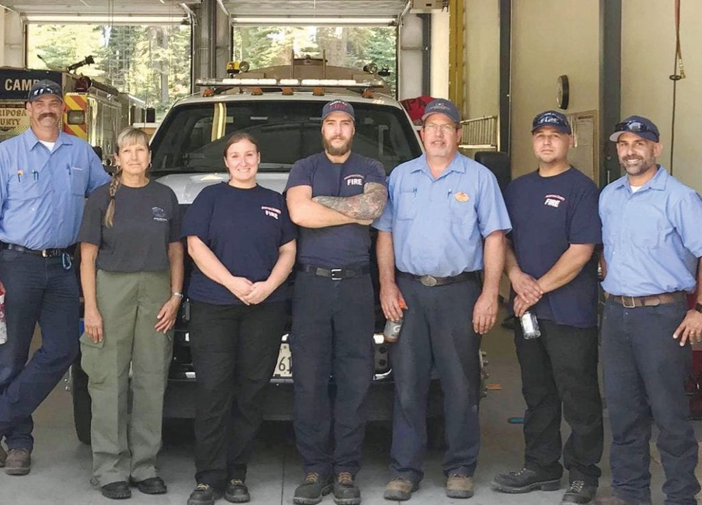 Shown is the crew which mans the fire station in Fish Camp 24 hours a day, seven days a week. From left are Darrold Swallow, Ricki Murano, Kelly Lucero, Josh Willis, Don Ubben, Jonas Gonzales and Johnathan Morris. (Not shown is Larry Weise.)