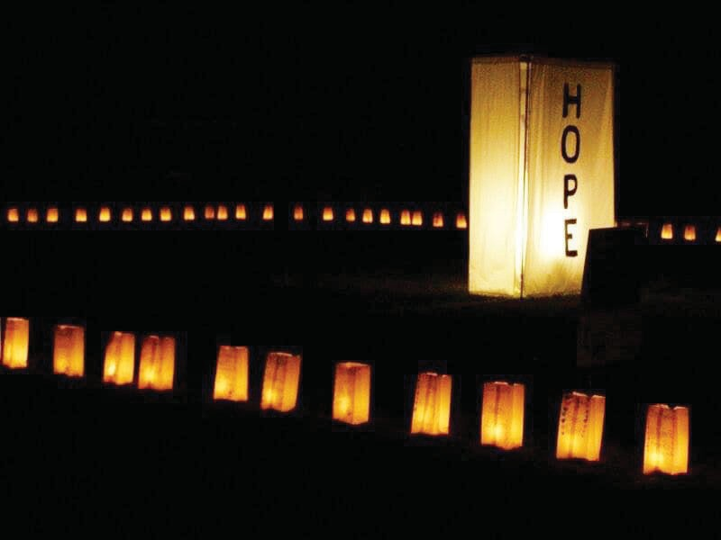 The Luminaria Ceremony is one of the most special moments at Relay as the track is illuminated by glowsticks placed in bags decorated in remembers of those who have fought cancer. Photo courtesy Mariposa for a Cure