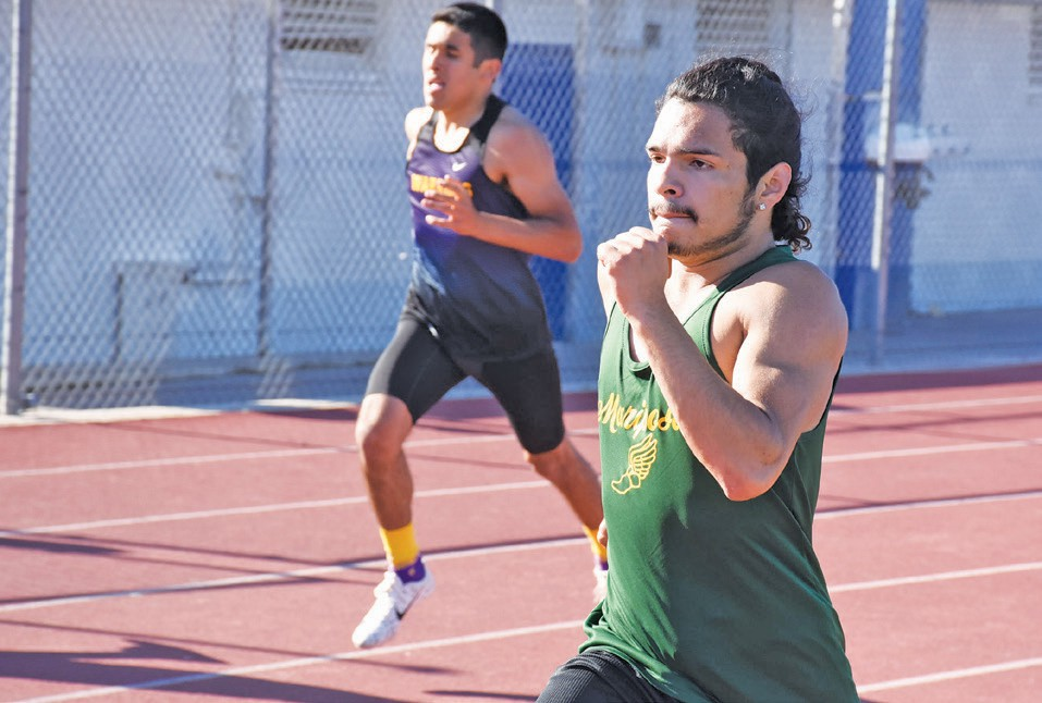 Ivan Morales (right) is one athlete who is still in high school who was mentioned on the All-Decade track team. Photo by Matt Johnson