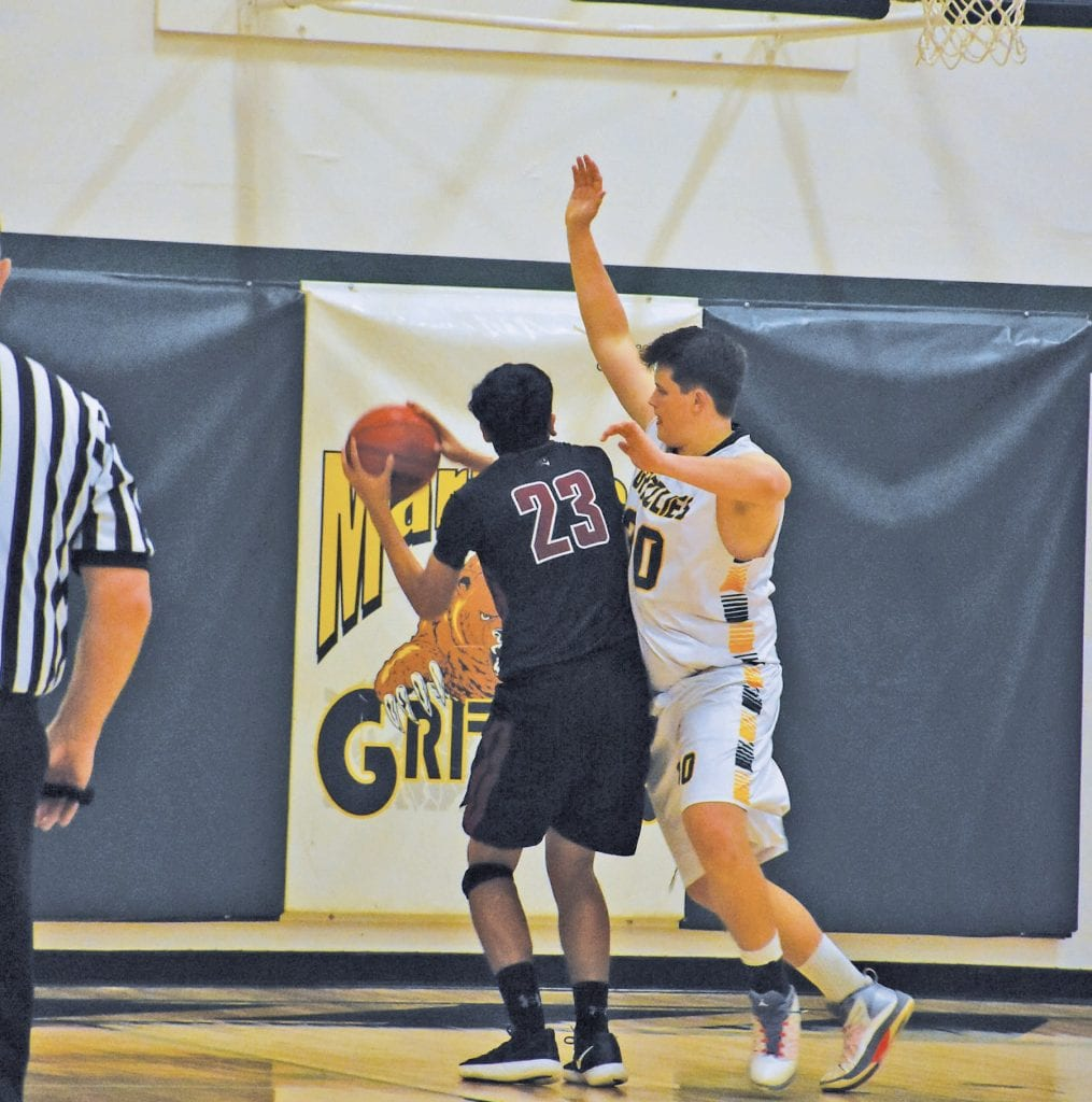 Isaiah Lura-Holmes (right) was a vital piece to the MCHS boys hoops team due to his size, rebounding, and improved play overall.