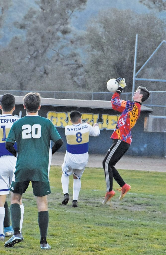 Mariposa goalkepeer Zach Fincher (right) became one of coach Miguel Ramirez's most reliable players. Photo by Matt Johnson