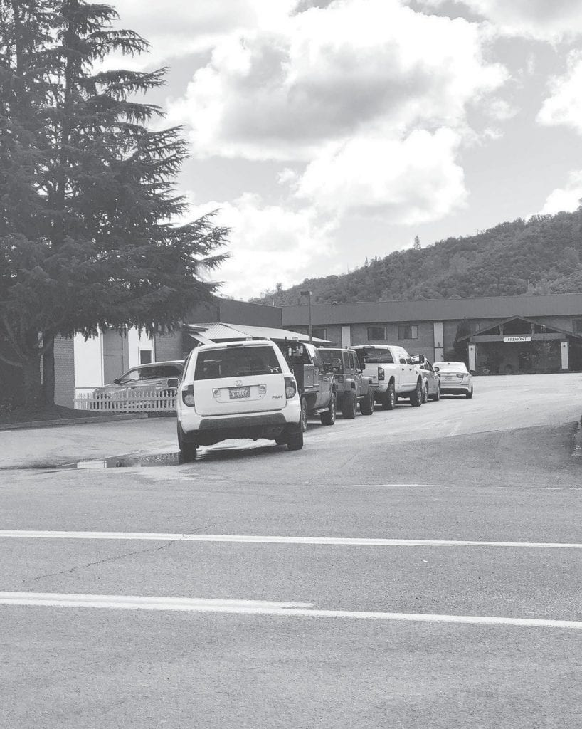 With the drive-through window as the main method for helping customers at Yosemite Bank, the lines are long, as shown in this photo from last Friday. Photo by Shantel Wight