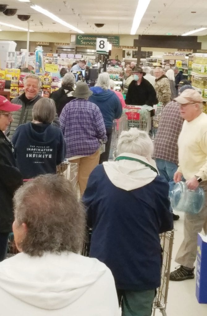 The lines were long Tuesday morning at Pioneer Market where senior citizens were allowed to shop following changes made by the supermarket. Photo courtesy Ron Iudice