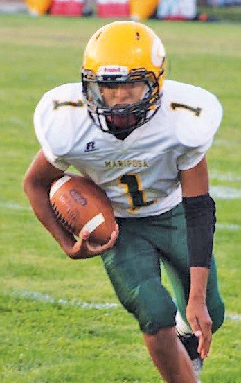 Angel Manuel Haro Villareal was found dead in a vineyard last week. He was loved by many in the Mariposa area. Angel is shown playing football for Mariposa County High School. Photo by Tammi Richards