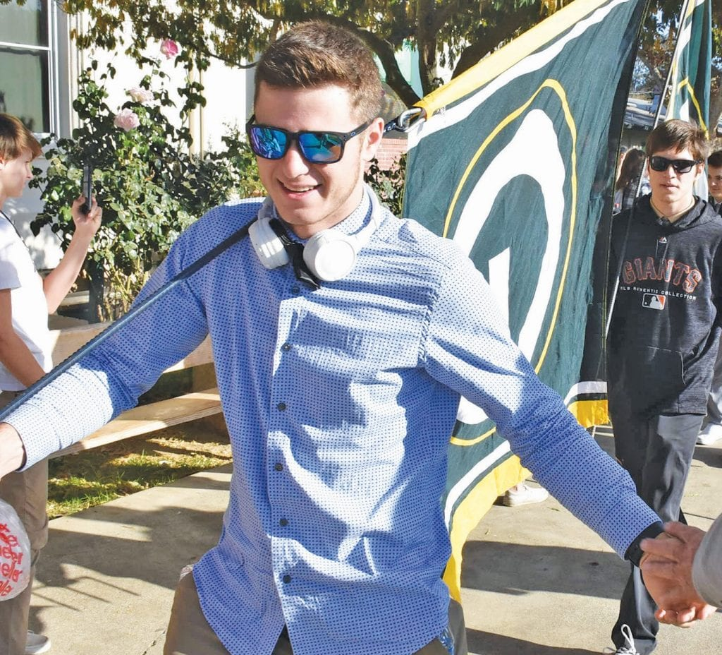 JC Davies is shown at a rally held on the MCHS campus, just prior to the players hopping on a bus to drive to the section title game for football. Photo by Matt Johnson