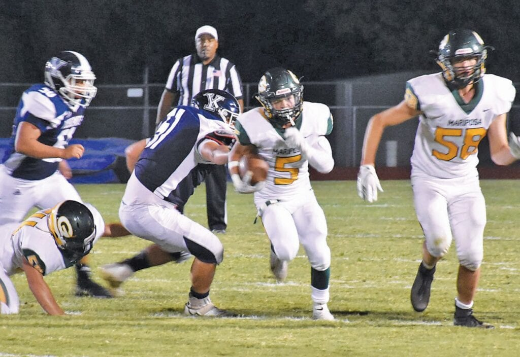 Logan Donati (center) was a threat on the football field whenever he touched the ball. Photo by Matt Johnson