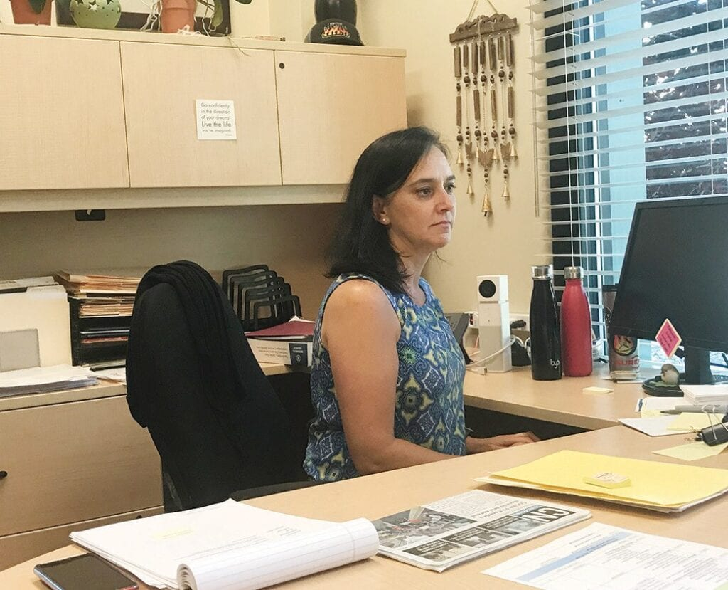 Chevon Kothari works at her desk at Mariposa County Health and Human Services in Mariposa. She will be leaving her position to take a job with the state of California. Photo by Greg Little
