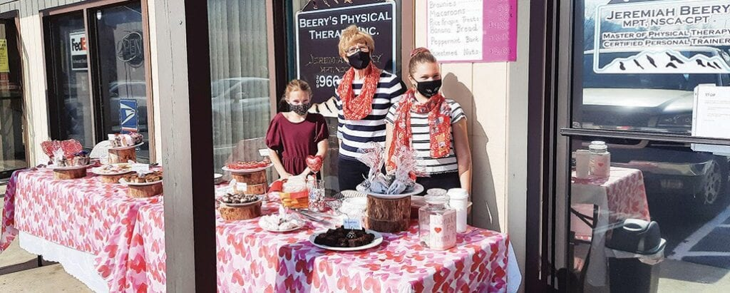 Sisters Grace (right) and Abbey (left) Beery are shown with the grandmother, Kathy Sutherland, during the recent fundraising event. Submitted photo