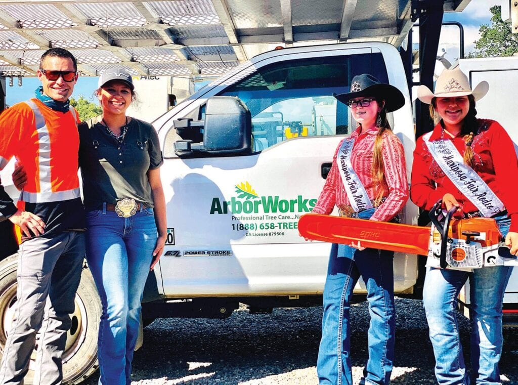 Shown from left, are Chriso Lee, vice president of ArborWorks, Inc., with Mariposa Mountain Riders board member and youth coordinator Desiree Turck, and Mariposa County Fair Rodeo Princess Tillyanna Healey and Junior Princess Desire Turck. Submitted photo