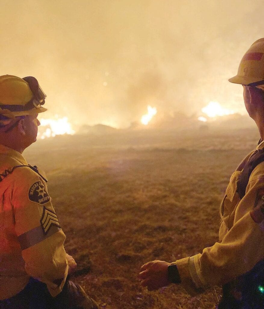 Madera County Sheriff's Office personnel are shown working overnight with CAL FIRE and multiple other agencies to stop the River Fire, burning in Madera and Mariposa counties. As of Tuesday morning, the blaze was at 9,500 acres with 15 percent containment. Photo courtesy Madera County Sheriff's Office