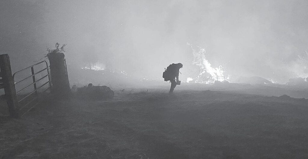 Emergency personnel are working around the clock to fight the River Fire, including proactive patrol of evacuated areas as shown in this Madera County Sheriff's Office photo. The situation was being closely monitored as crews on the ground and in the air battled the fire back to prevent it from spreading into more populated areas including Ahwahnee and Oakhurst. Photo courtesy Madera County Sheriff's Office