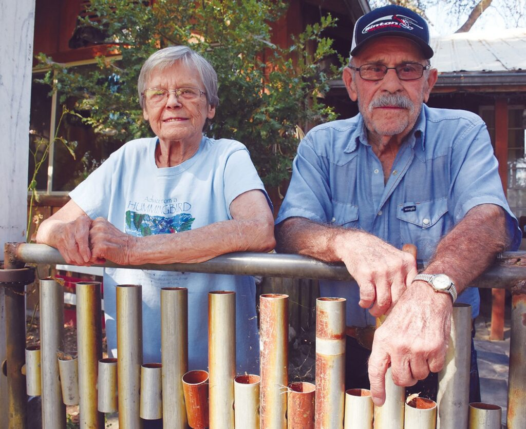 """Duane """"Bo"""" and Joann (Williams) Beaudoin pose for a portrait outside their Bootjack home last Friday. The couple will serve as the grand marshals of the annual Lions Club Labor Day Parade on Saturday. Photo by Allen Laman"""