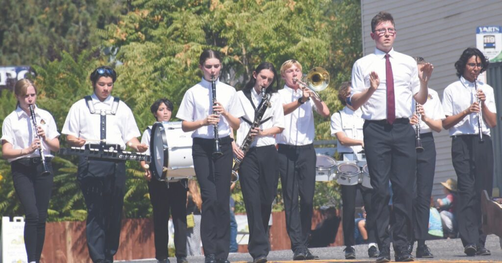 """The Mariposa County High School band marched down Highway 140 while playing a rendition of """"Safe and Sound,"""" a popular alternative song by Capital Cities that debuted in 2013. Photo by Allen Laman"""
