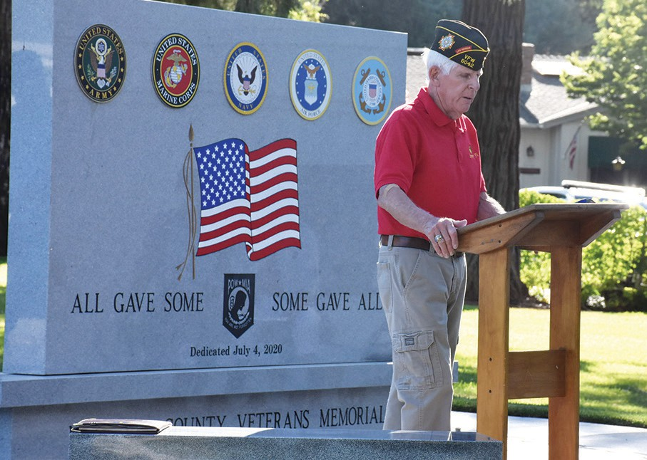 Shown above is Bill Yaley, chairman of the Veterans Memorial Committee, speaking at the memorial last year when an unofficial ceremony was held with limited attendance because of the pandemic. On Nov. 13, the community is invited to the formal dedication as well as a free lunch on the grounds of the courthouse in Mariposa